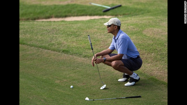 President Barack Obama golfs in Kailua, Hawaii, on Monday, December 23, while on a two-week vacation. Here's a look at how Obama and other presidents have escaped from the pressure of the Oval Office.