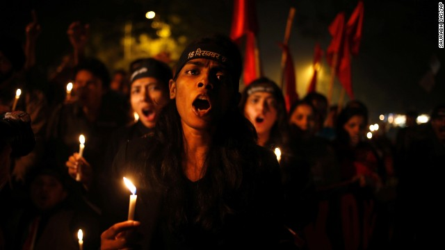Indians hold a candlelight vigil on the first anniversary of the brutal rape and murder of a young female physiotherapy student in New Delhi on December 16, 2012. Her tragedy awakened the world to the crisis of violence against women in India.