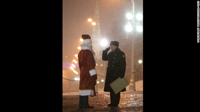 A timber truck driver dressed as Father Frost is seen at the Kremlin's Spasskiye [Saviour] Gate on Saturday, December 21.