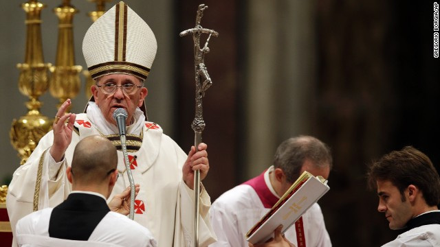 Pope Francis delivers a blessing at the end of the Christmas Eve Mass in St. Peter's Basilica at the Vatican on Tuesday, December 24. The Pope rang in his first Christmas at the Vatican with a Christmas Eve Mass preaching a message of love and forgiveness.