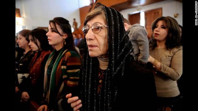 Iraqi Christians attend a Christmas Mass in Basra, Iraq.