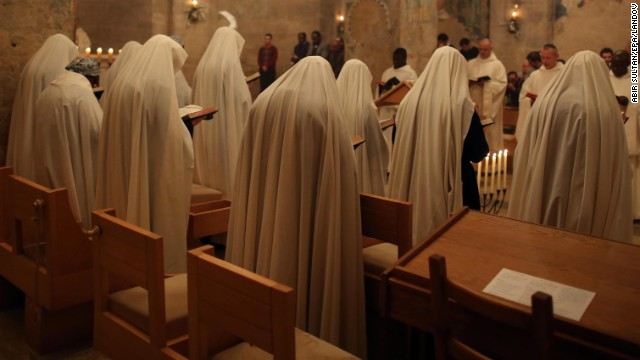 Catholic nuns perform a midnight Christmas Mass in Abu Ghosh, Israel, outside Jerusalem.