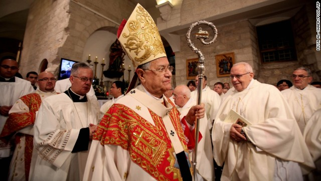 Latin Patriarch of Jerusalem Fouad Twal leads midnight Christmas Mass at the <a href='http://whc.unesco.org/en/list/1433' target='_blank'>Church of the Nativity</a>, which Christians traditionally believe to be the site of the birthplace of Jesus Christ, in Bethlehem, West Bank.