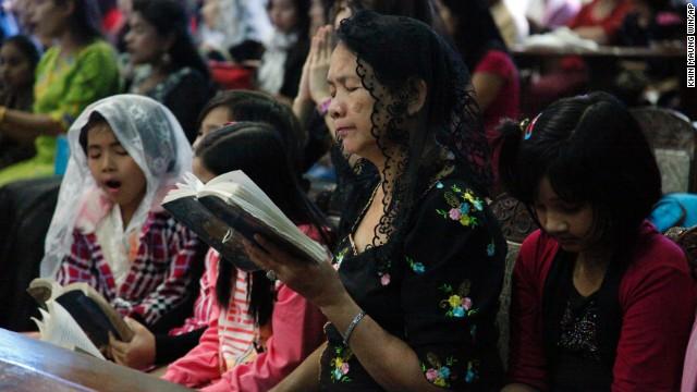 People pray during a Christmas Mass in Yangon, Myanmar.