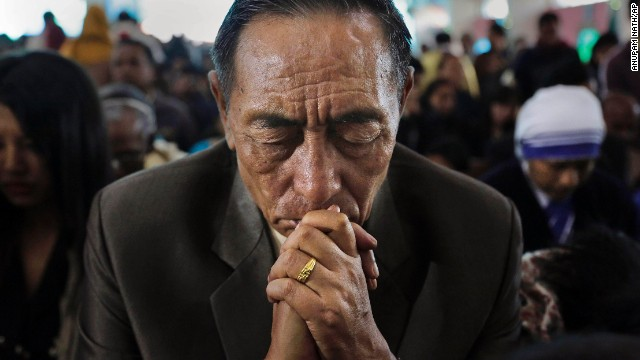A man prays during Mass in Guwahati, India, on Christmas Day, December 25. Take a look at Christmas celebrations from around the world: