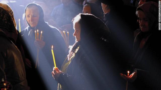 Women attend a Mass in Malaia, Romania.