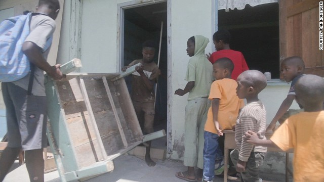 Villagers in Sandvoort come out to help clean up the future library space.