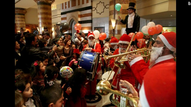 People celebrate Christmas at a party in a Damascus, Syria, hotel.