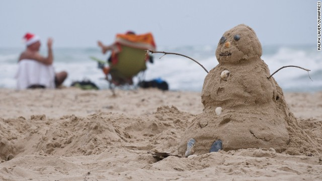 A sandman takes the place of a snowman in South Padre Island, Texas.