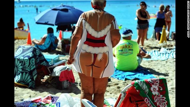 People enjoy Waikiki Beach on Christmas Day in Honolulu.