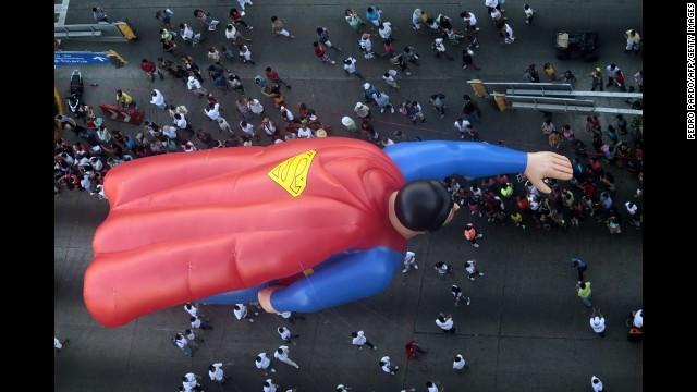 A giant balloon Superman participates in the Christmas parade in Acapulco, Mexico.