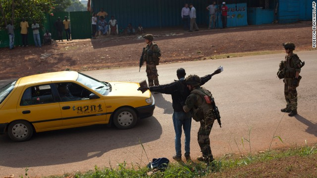 French soldiers frisk a man at a checkpoint in Bangui on December 23.