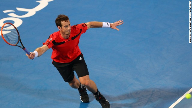 Andy Murray was beaten in straight sets by Jo-Wilfried Tsonga at an exhibition tournament in Abu Dhabi on Thursday.