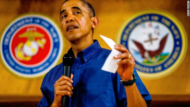 Obama signs budget, defense bills in Hawaii