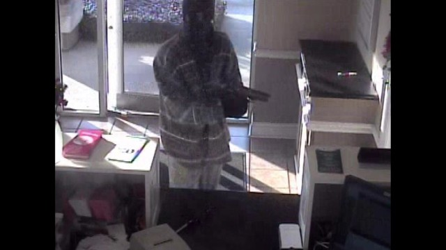 A nationwide manhunt seeks the suspect in Monday's bank robbery and fatal shooting in Tupelo, Mississippi.