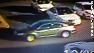 Police are looking for this dark gray Dodge Stratus, which is believed to be the getaway vehicle.