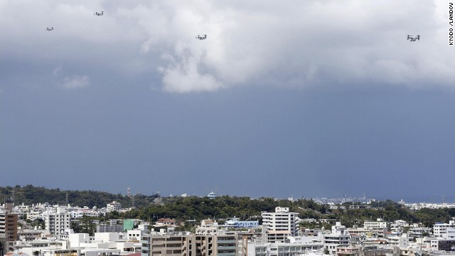MV-22 Osprey aircraft head for the U.S. Marine Corps' Futenma Air Station on August 12, as the U.S. military resumed transport of Ospreys from the Iwakuni base after a fatal helicopter crash.