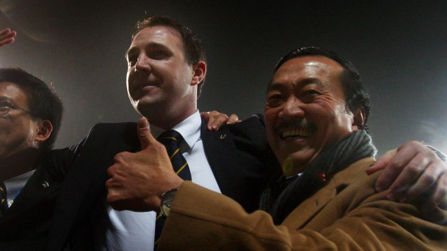 All together then: Vincent Tan (far right) and Malky Mackay celebrate an English League Cup semifinal win in 2012.