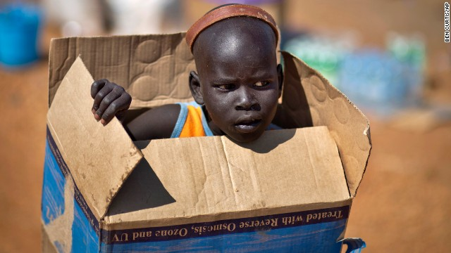 <strong>December 27: </strong>A boy carries a cardboard box in Juba, South Sudan, inside a United Nations compound that has become home to thousands of people displaced by recent fighting in the fledgling African nation.