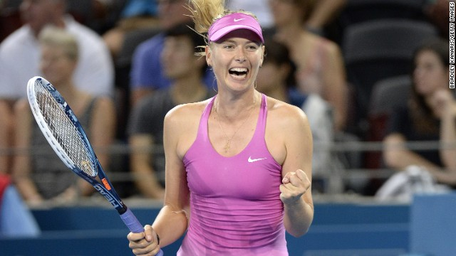 Maria Sharapova celebrates her comeback victory against Caroline Garcia of France during day two of the 2014 Brisbane International in Queensland.