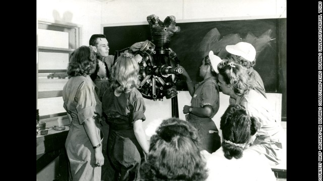 WASPs study in engines class with instructor Mr. Crawford, at Avenger Field, Sweetwater, Texas.<!-- --> </br>