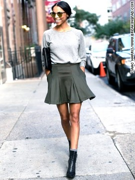 Lloyd pairs a neoprene skirt with a sweatshirt and heels for a sport-meets-chic look. Neutral tones keep the ensemble sophisticated, she says.
