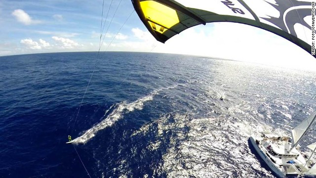Kiteboarding harnesses the power of the wind using a large kite suspended on four lines and has grown in popularity in recent years.