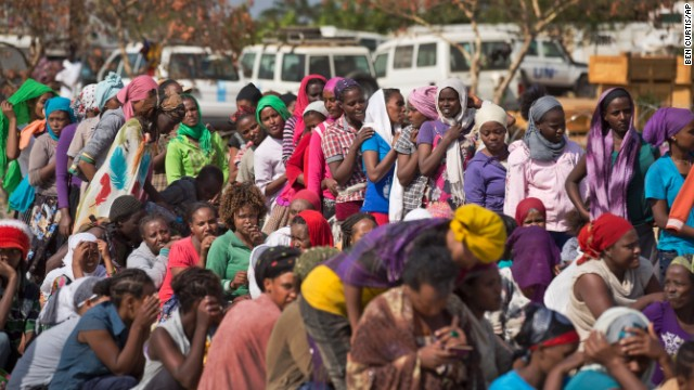 Displaced women wait in line inside a U.N. camp in Malakal on December 30.