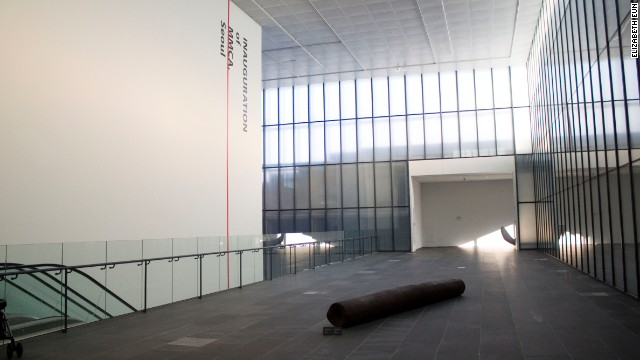 "A wall of windows keeps the first floor of Seoul's MMCA brightly lit. This section of the museum currently features Choi In Su's ""At the Edge of Sound,"" made in 1992 from cast iron."