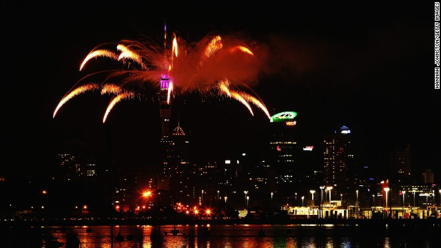 Fireworks are set off from the Auckland Sky Tower in Auckland, New Zealand, to celebrate the first New Year's celebration of 2014.