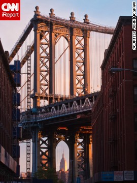 The Empire State Building peeks out from under Manhattan Bridge in this shot from Brooklyn. See more photos from around New York on CNN iReport.