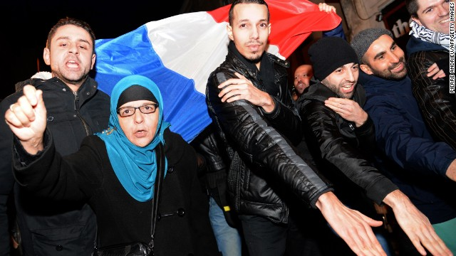 "The ""quenelle"" gesture has been popularized by the anti-establishment French comedian Dieudonne, who has been condemned in France for anti-Semitism. Here people perform the ""quenelle"" in front of Dieudonne's theater, while protesting against French interior minister Manuel Valls who has called for Dieudonne's performances to be banned."