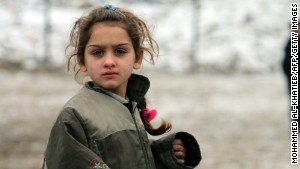 A Syrian girl plays in the city of Aleppo, bombed two days after this photo was taken on December 13.\n