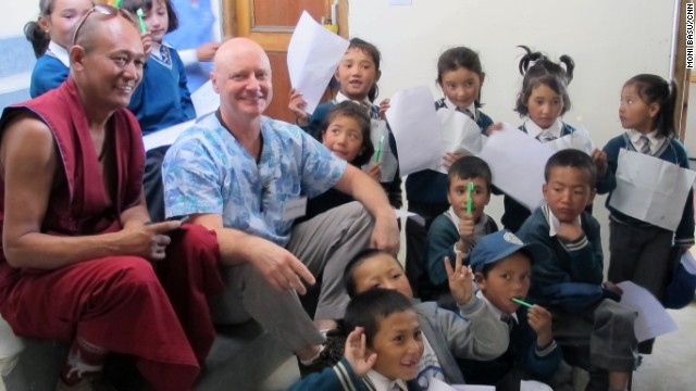 Dentist Raymond Broussard, center, relaxes with kids he examined at the volunteer clinic in Leh.