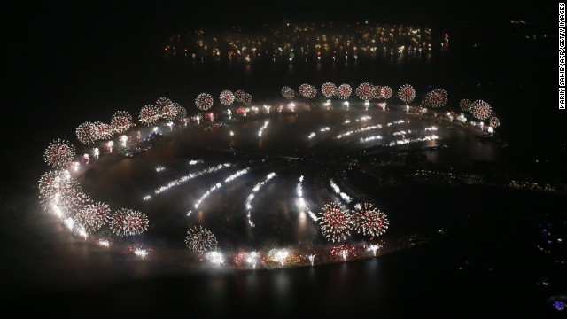 New Year's fireworks explode over Palm Jumeirah in Dubai, United Arab Emirates. Dubai set a new world record for largest fireworks display, according to Guinness World Records. The show featured 400,000 pyrotechnics and spanned more than 100 kilometres (62 miles).