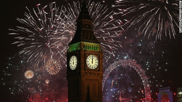 Fireworks light up Big Ben and the London skyline during New Year's celebrations.