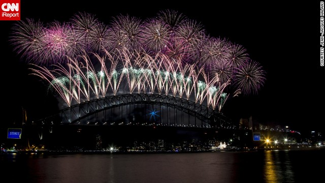Happy New Year! Fireworks shoot from Sydney Harbour Bridge at midnight. See more spectacular photos on CNN iReport.