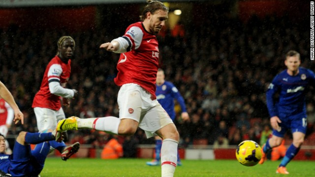 Niklas Bendtner powers Arsenal ahead in the 88th minute of their home EPL match against Cardiff City.