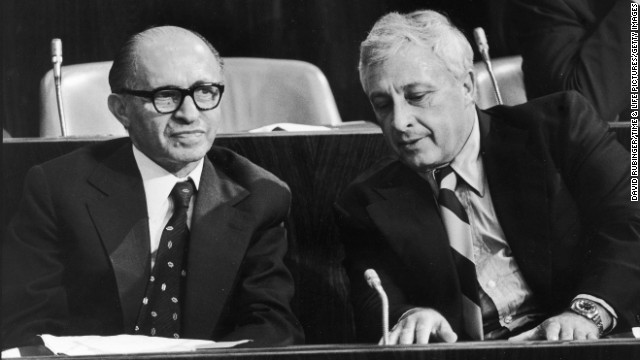 Sharon transitioned into government, including stints as military adviser, agriculture minister and defense minister. Here, he and Prime Minister Menachem Begin attend a Knesset meeting in June 1977.