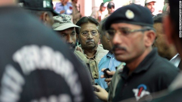 Musharraf is escorted by soldiers as he arrives at an anti-terrorism court in Islamabad in April 2013.