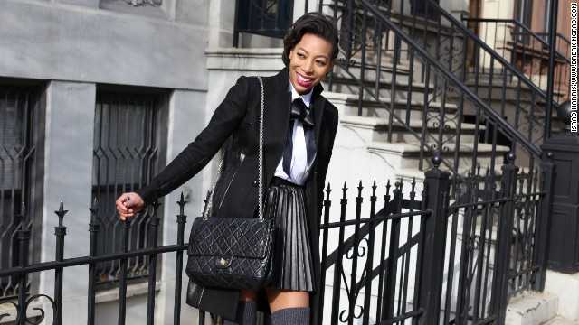 Lloyd's sister, Jessica, models a grown-up, schoolgirl-inspired look with a DIY satin bow tie and a vegan leather pleated skirt.