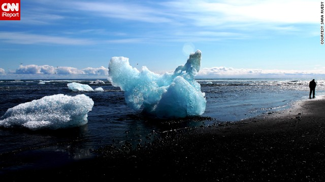 Vibrant blue icebergs wash up on black volcanic sand beaches in the glacial lagoon of Jokulsarlon. See more photos on <a href='http://ireport.cnn.com/docs/DOC-821175'>CNN iReport</a>.
