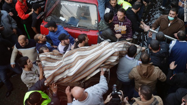 People carry a covered body from the site of the explosion.