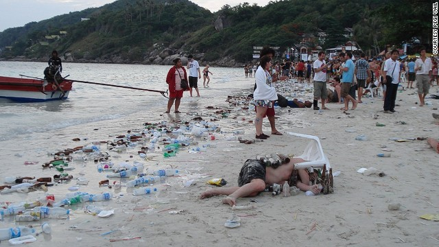 "A scene in the documentary ""Gringo Trails"" shows the litter-strewn aftermath of a tourists' full moon party on Haad Rin, Koh Pha Ngan, Thailand."