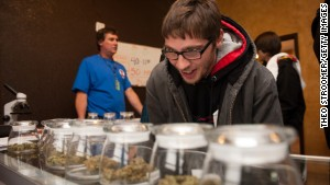 Tyler Williams of Blanchester, Ohio, looks over marijuana strains at the 3-D cannabis dispensary on January 1 in Denver, Colorado.\n