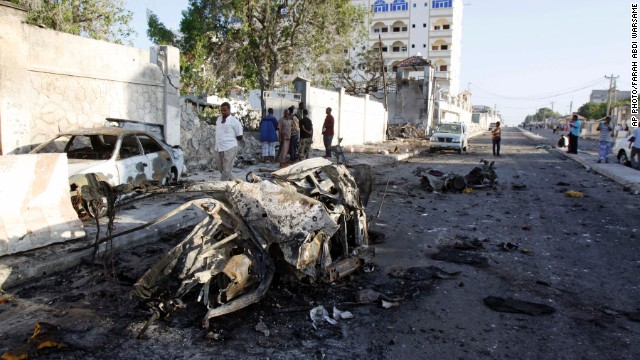 Wreckage of cars is seen outside the Jazeera Hotel, in Mogadishu, Somalia, Thursday, January 2, 2014.