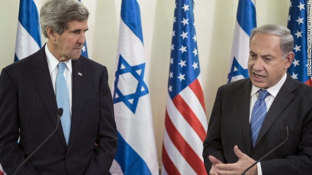 U.S. Secretary of State John Kerry listens on Thursday as Israeli Prime Minister Benjamin Netanyahu makes a statement before a meeting at Netanyahu's office in Jerusalem.