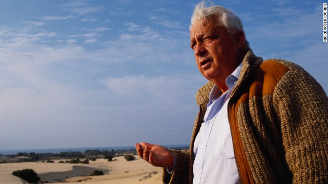 Sharon, no longer in the Israeli military, stands at the future site of a settlement in Gaza in February 1990.