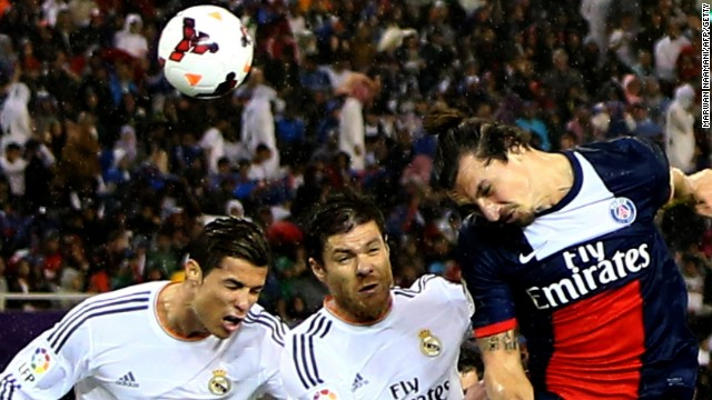 Xabi Alonso is the meat in the superstar sandwich as Cristiano Ronaldo (left) and Zlatan Ibrahimovic vie for a high ball.