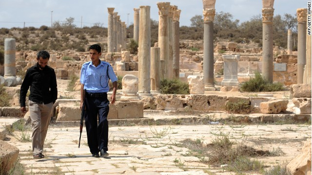 This file photo shows a Libyan officer patrolling with tourist police in Sabratha, a city on the Mediterranean coast, west of Tripoli in 2011.
